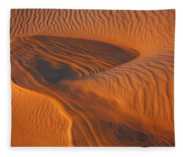 Woman In The Dunes Fleece Blanket
