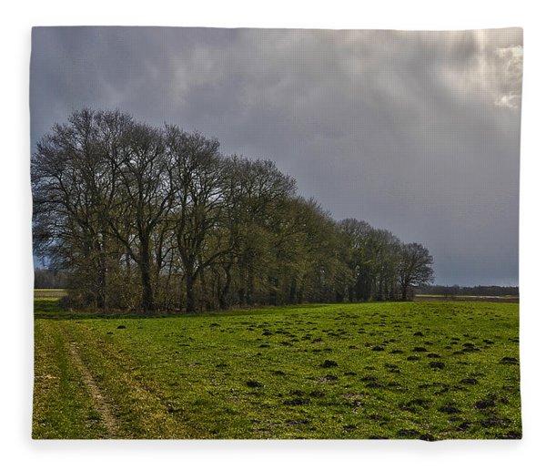 Group Of Trees Against A Dark Sky Fleece Blanket