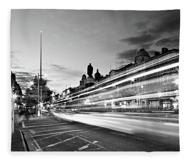 Fleece Blanket featuring the photograph Light Trails On O'connell Street At Night - Dublin by Barry O Carroll
