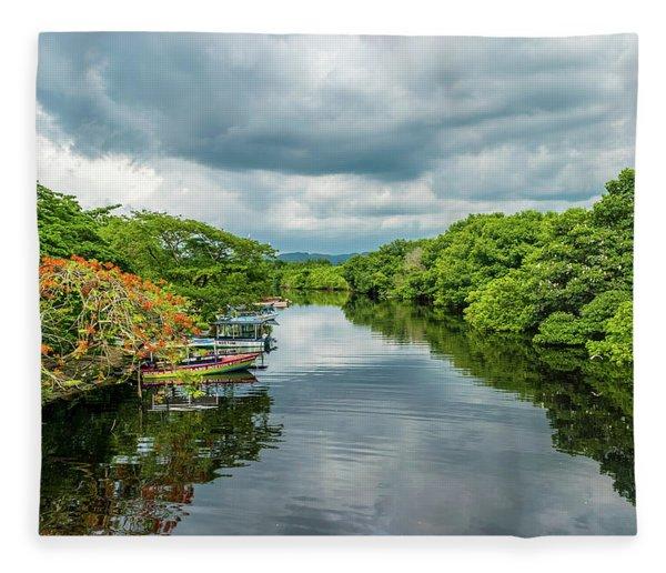 Cloudy Skies Over The River Fleece Blanket