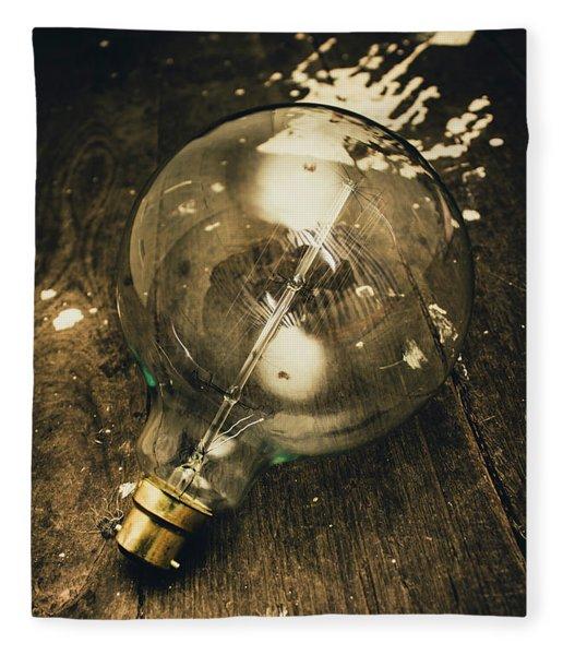 Vintage Light Bulb On Wooden Table Fleece Blanket