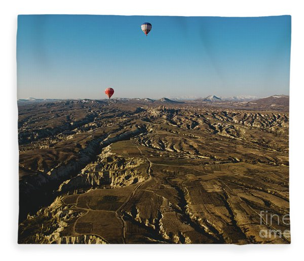 Colorful Balloons Flying Over Mountains And With Blue Sky Fleece Blanket