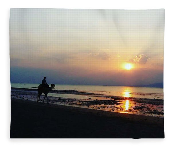 Camel Walking Along The Shoreline At Sunset In Egypt Fleece Blanket