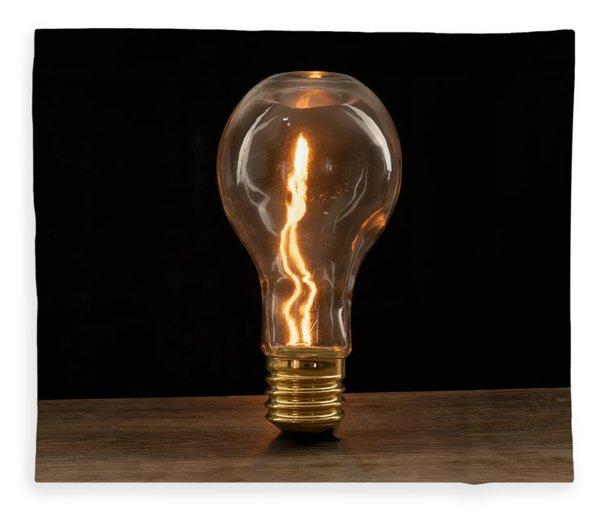 Fire Sparks Inside A Light Bulb Fleece Blanket