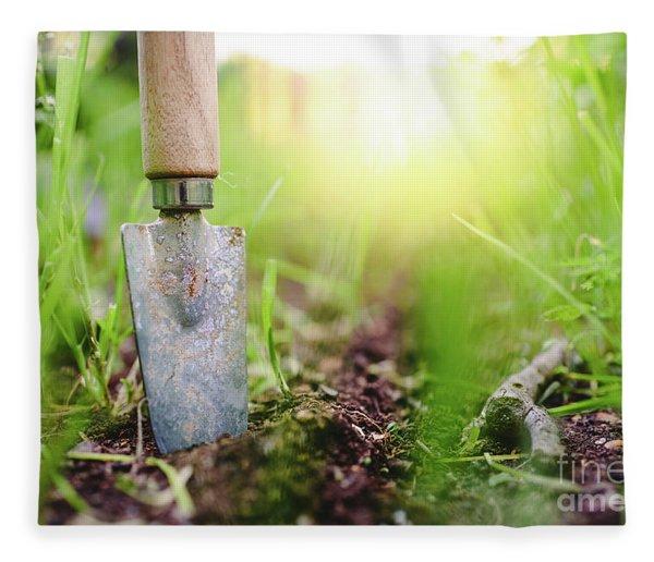 Gardening Shovel In An Orchard During The Gardener's Rest Fleece Blanket