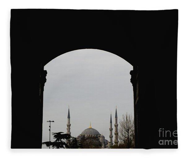 minarets in the city for the prayer of the Muslim religion Fleece Blanket