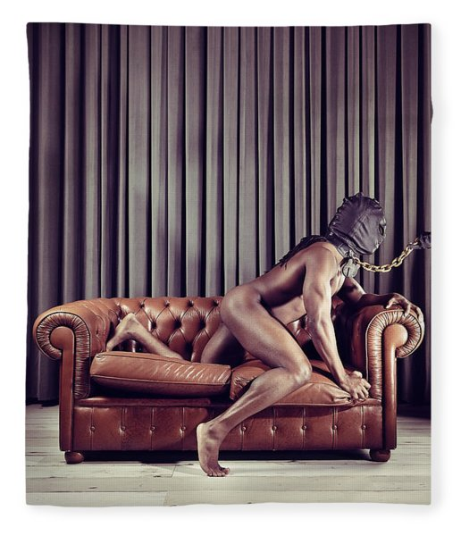 Naked Man With Mask On A Sofa Fleece Blanket