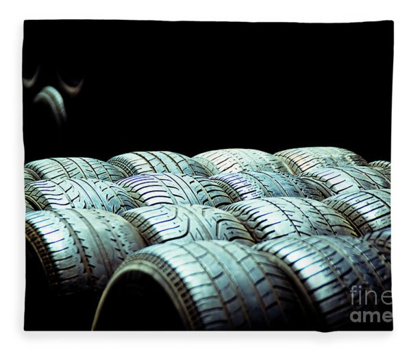 Old Tires And Racing Wheels Stacked In The Sun Fleece Blanket