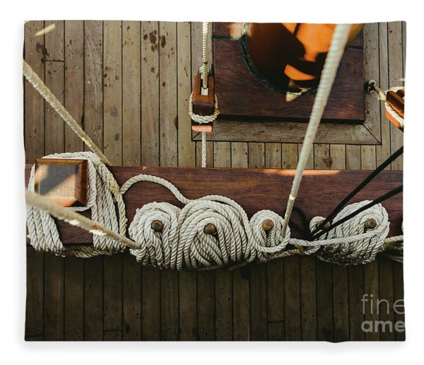 Ropes To Hold The Sails Of An Old Sailboat Rolled. Fleece Blanket