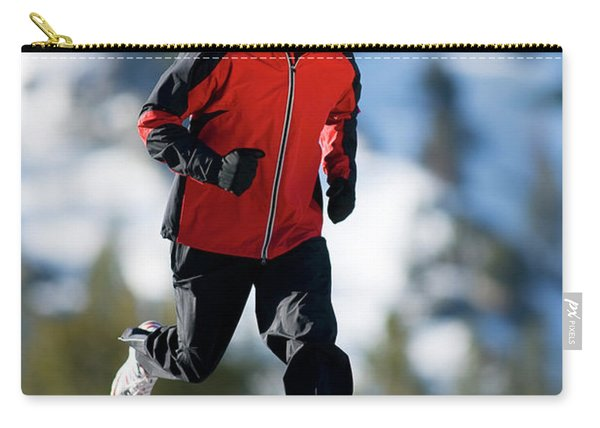 A Man Runs Alone On A Late Winter Day Carry-all Pouch