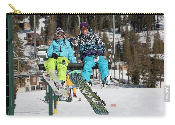 A Snowboarder And A Skier Ride Carry-all Pouch