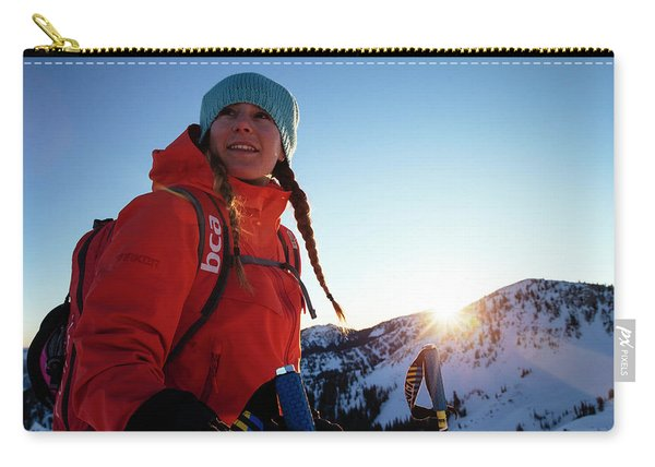 A Woman Backcountry Skiing Carry-all Pouch