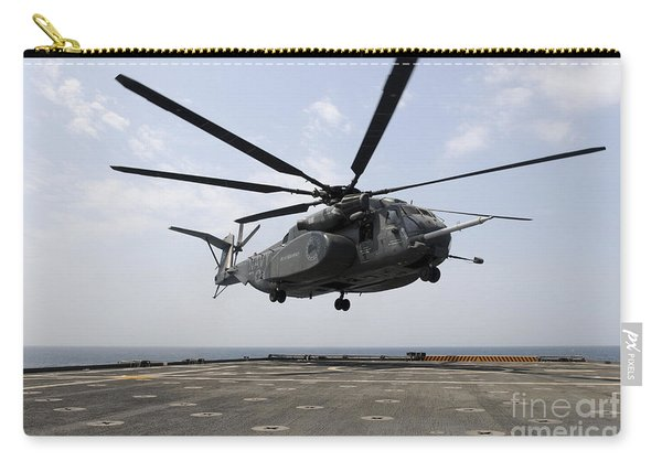 An Mh-53e Sea Dragon Prepares To Land Carry-all Pouch