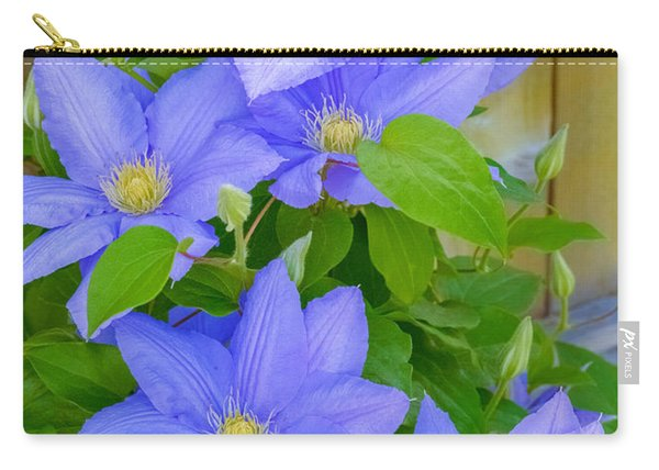 Carry-all Pouch featuring the photograph Clematis  by Garvin Hunter