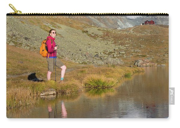 A Female Hiker Is Standing Carry-all Pouch