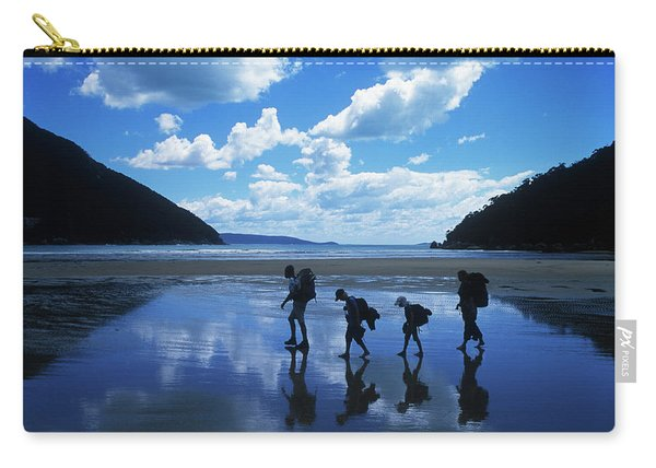 A Family Of Hikers Walks Carry-all Pouch