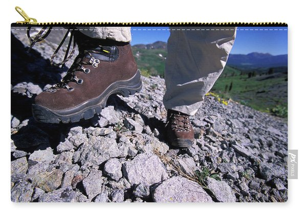 A Female Hiker Goes Up A Rocky Trail Carry-all Pouch