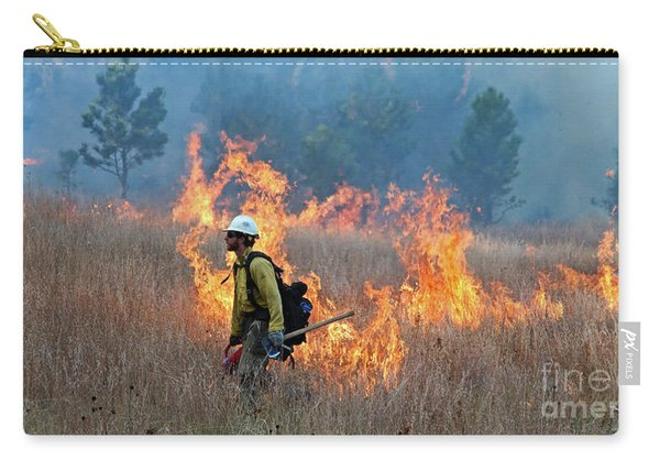 Carry-all Pouch featuring the photograph A Firefighter Ignites The Norbeck Prescribed Fire. by Bill Gabbert
