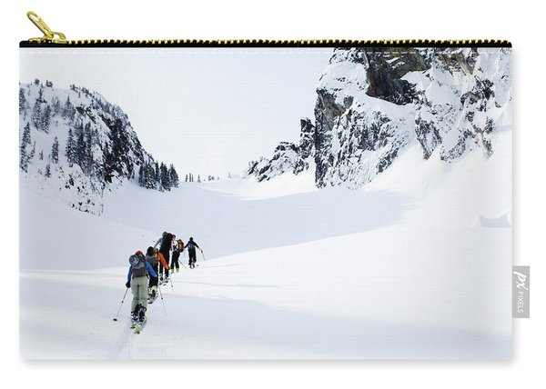 A Group Of Skiers In The Backcountry Carry-all Pouch