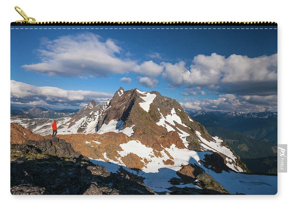A Hiker Stands On A Rocky Ridge Carry-all Pouch