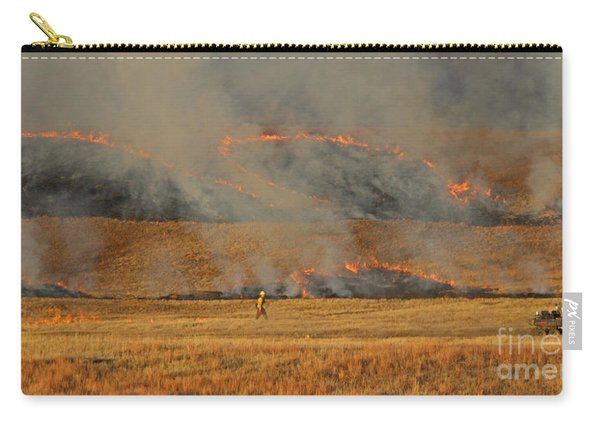Carry-all Pouch featuring the photograph A Lone Firefighter On The Norbeck Prescribed Fire. by Bill Gabbert