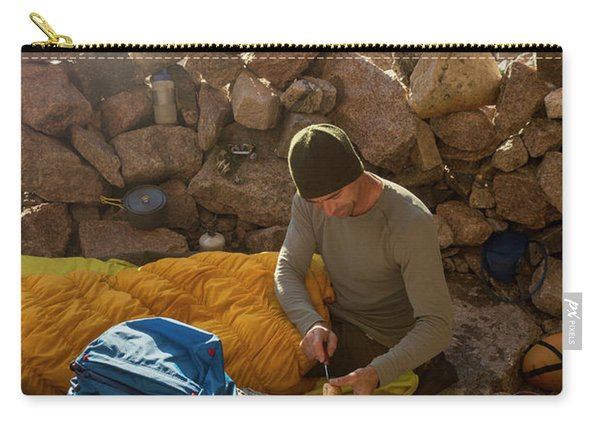 A Male Mountain Climber Getting Ready Carry-all Pouch