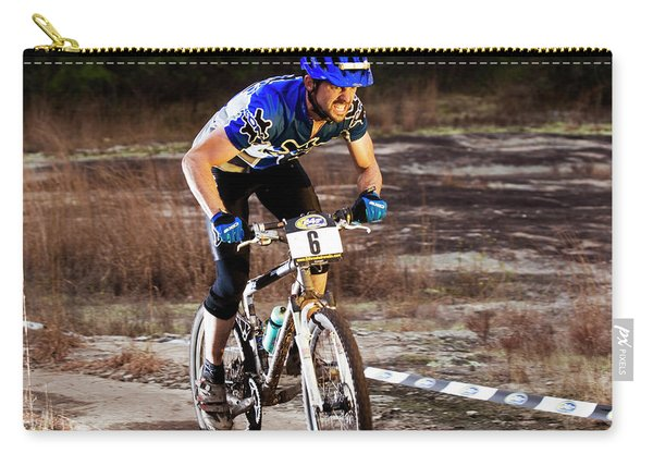 A Man Rides Aggressively Up A Muddy Carry-all Pouch