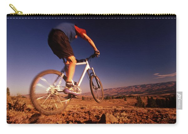 A Mountain Bike Rider On A Ride Carry-all Pouch