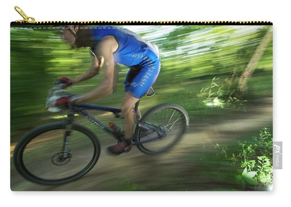 A Mountain Biker Races On A Trail Carry-all Pouch