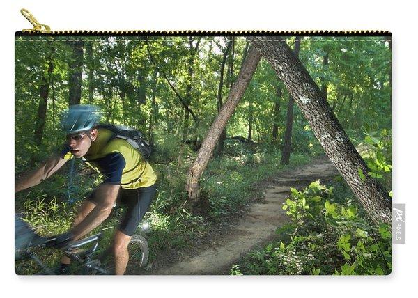 A Mountain Biker Speeds Down A Winding Carry-all Pouch