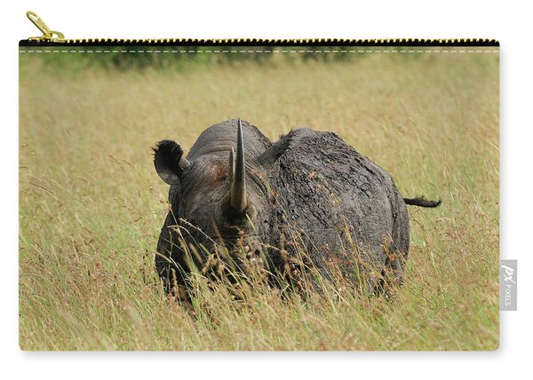 A Rhino Standing In The Grass Carry-all Pouch