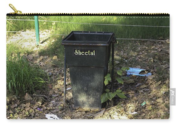 A Rubbish Bin Inside The Delhi Zoo Nestled Among Old Leaves Carry-all Pouch