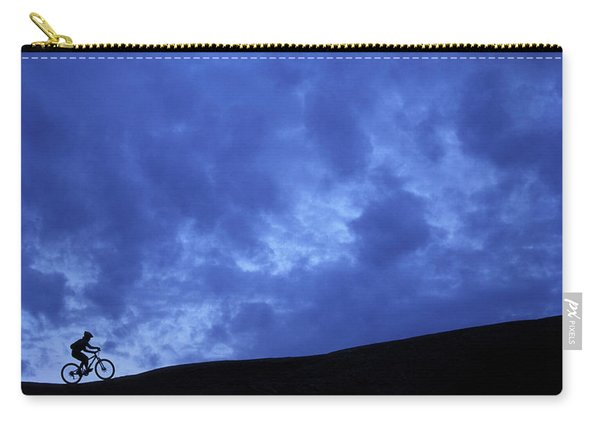 A Silhouette Of A Woman Mountain Biking Carry-all Pouch