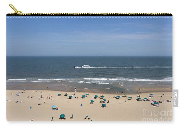 A Touring Speedboat Passes By Shore In Ocean City Maryland Carry-all Pouch