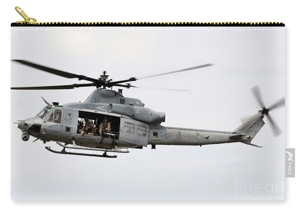 A Uh-1y Huey Hovers Around A Ship Carry-all Pouch