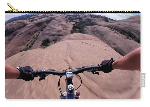 A View Of A Female Mountain Bikers Carry-all Pouch