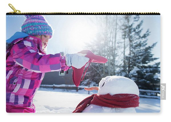 A Young Girl Building A Snowman Carry-all Pouch