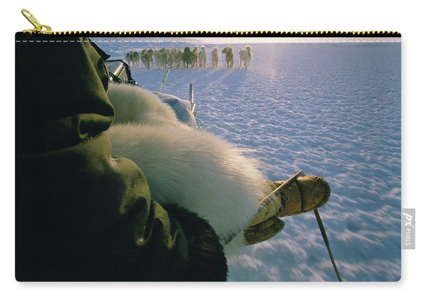An Inuit Hunter Skillfully Guides Carry-all Pouch