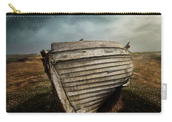 Carry-all Pouch featuring the photograph An Old Wreck On The Field. Dramatic Sky In The Background by Jaroslaw Blaminsky