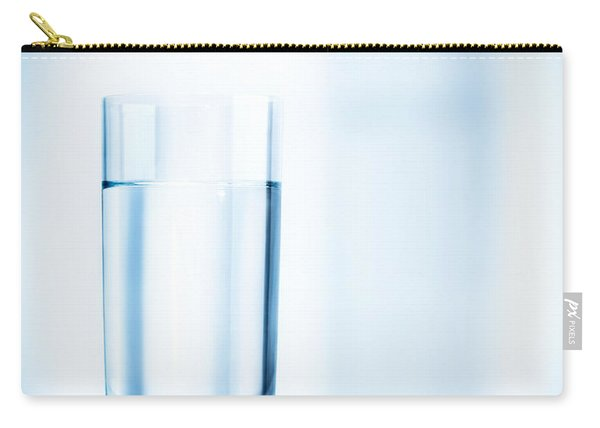 Glass Of Water On Light Blue Background Carry-all Pouch