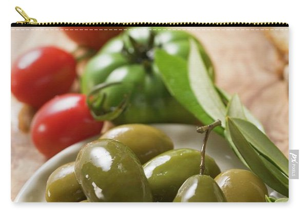 Green Olives On Plate, A Few Tomatoes Behind Carry-all Pouch