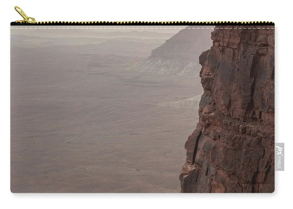 Hiker Standing At Sharp Cliff Edge Carry-all Pouch