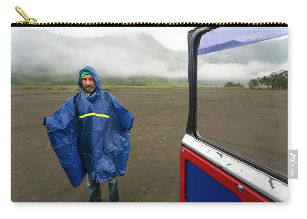Man In Rain Coat With Volcanic Carry-all Pouch