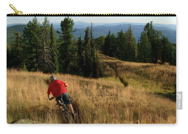 Man Rides Trail At Sunset Carry-all Pouch