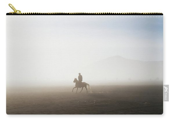 Man Riding A Horse In The Tengger Sand Carry-all Pouch
