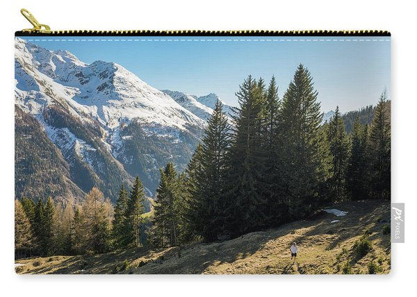 Man Trail Running In The Mountains Carry-all Pouch