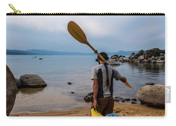 Man With A Paddle Over His Shoulder Carry-all Pouch