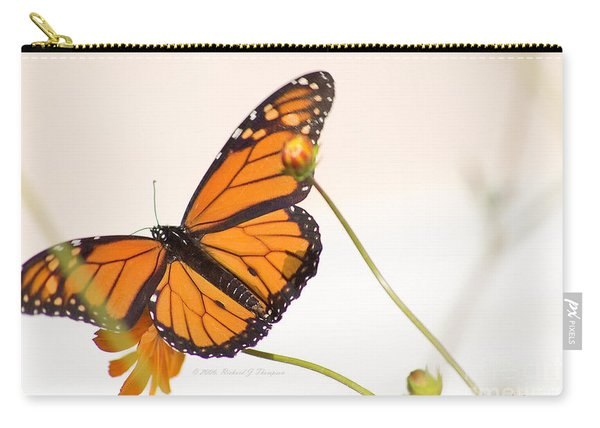 Carry-all Pouch featuring the photograph Monarch Butterfly In Flight by Richard J Thompson