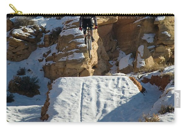 Mountain Biker Jumping With Snowy Carry-all Pouch