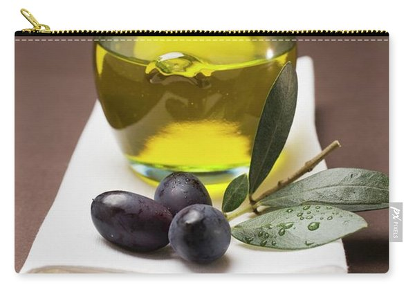 Olive Sprig With Black Olives, Jar Of Olive Oil Behind Carry-all Pouch